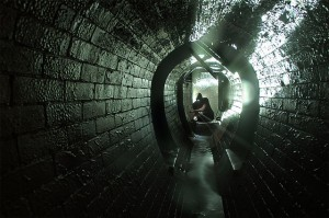 Personal kneeling in stone tunnel, photo credit jondoe via flickr