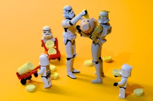 stormtroopers loading piggy banks with coins