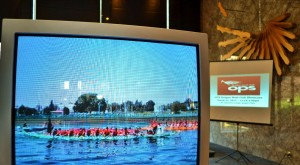 OPSDBC-2012-Showcase-showing-video-of-dragon-boat-with-presentation-in-background-300x165